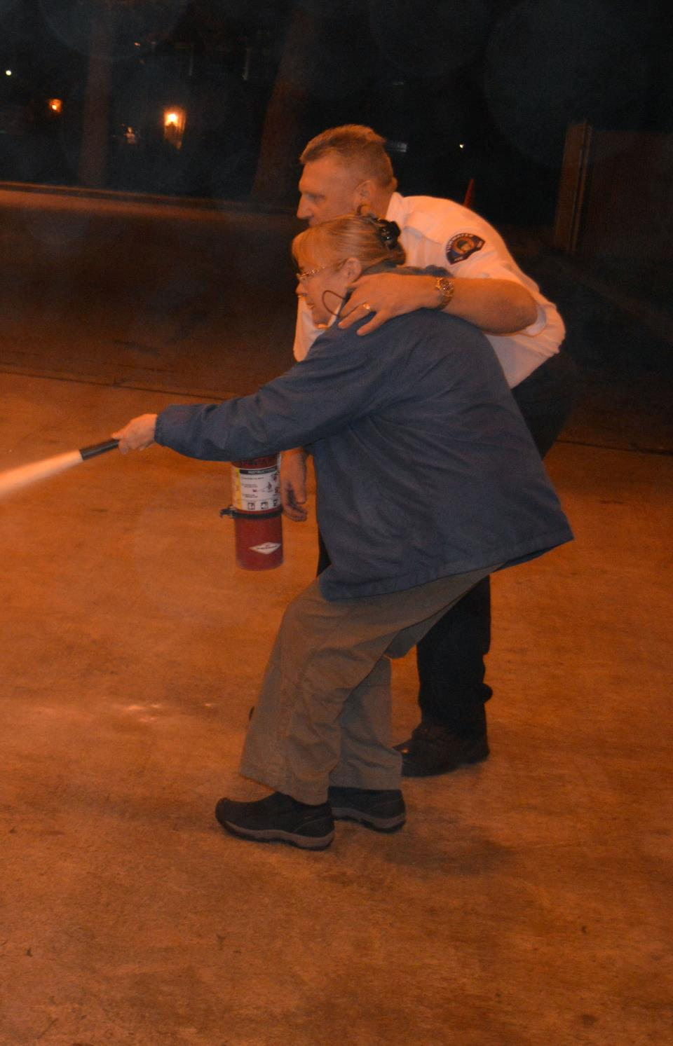 2016-02-23 Fire Chief and Woman Use Fire Extinguisher cropped